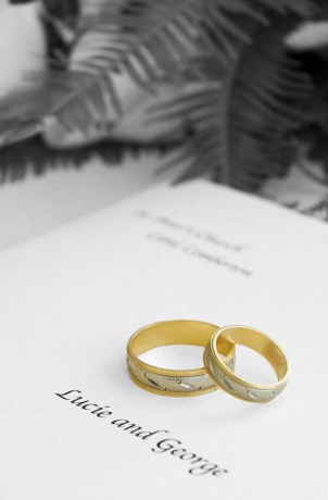 Wedding rings and order of service. Wedding photography by Derbyshire and Chesterfield photographer Chris James